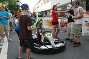 A young fan checks out a racing kart at Food Lion Speed Street.