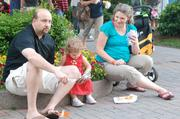 A family enjoys the festival foods available at Speed Street.