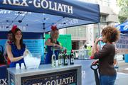 Representatives from winery Rex Goliath offer samples to adult festival goers.