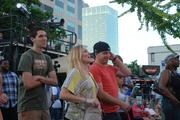 Speed Street attendees sing along with musical acts at the Coca-Cola stage.