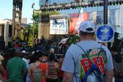 A crowd gathers at the Coca-Cola stage for musical performances during Speed Street -- and more than a few racing t-shirts can be spotted among the festival-goers.