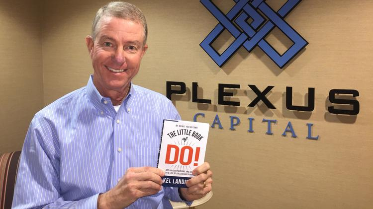 """Kel Landis III with his book, """"The Little Book of Do!"""""""