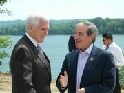 Indiana Gov. Mike Pence and U.S. Rep. John Yarmuth chatted prior to the press conference.