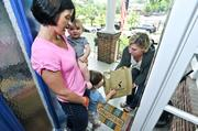 New mom Somer Jefferiss, with 6-month-old Malcolm and 2-year-old Winston, gets a delivery from Kristen Bocanegra, whose momme meals company makes frozen and organic meals with a nutrition profile ideal for new moms and their families.
