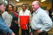 Grayson Hall, right, and Condoleezza Rice, second from the left, visit Scott Elementary School in Pratt City to talk with relief workers helping those impacted by the April 2011 storms.