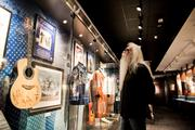 William Lee Golden of The Oak Ridge Boys looks through the clothing and instrument section.