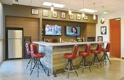 Enclaves and a kitchen bar highlight the new office space at Vaco in Tampa.