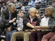 Co-owners Jamie Dinan (left) and Marc Lasry greet former Bucks player Michael Redd (at right) courtside.
