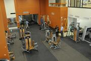 Weight machines take up the main floor at the Honolulu Club.