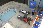 The outdoor spa on the eighth-floor rooftop at the Honolulu Club is being prepared for members to use some of the new water weights and life jackets for water aerobics classes.