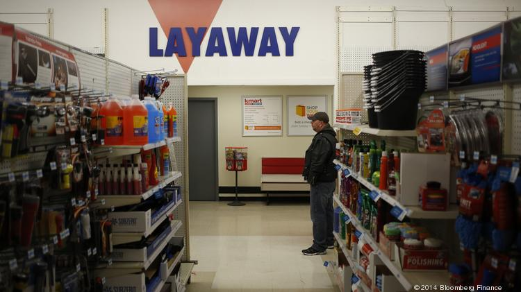 A shopper stands near the layaway counter at a Kmart discount store, operated by Sears Holdings Corp., as automobile cleaning and maintenance products sit in an aisle, ahead of Black Friday in Frankfort, Kentucky.