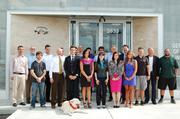Germain Infiniti's staff is led by General Manager Zach Germain, in suit behind the dog.