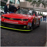 <strong>Dale</strong> <strong>Earnhardt</strong> Jr.'s car races through Downtown Jacksonville