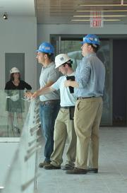 Colton Hill (left), project engineer with Kirchhoff Consigli;  Mike Ryan, project engineer with Skanska; and Jay Quackenbush, project manager with Kirchhoff Consigl; on the top floor of UAlbany's new School of Business building.