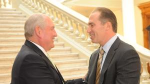 June 2009: Then-Georgia Gov. Sonny Perdue, left, shakes hands with NCR Corp. CEO Bill Nuti during the announcement that the company would move its headquarters from Dayton, Ohio, to Atlanta.