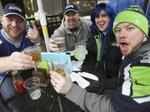 Downtown Seattle a sea of blue, green ahead of Seahawks playoff game against the Carolina Panthers
