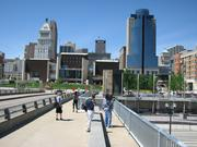 Reporters and pedestrians stand on the new pedestrian pathway connecting Covington and Cincinnati along the east side of the Roebling Suspension Bridge.
