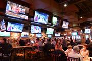 More than 65 televisions surround guests between the indoor and outdoor dining areas.