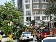 Parts of Center City are blocked off as firefighters help with removal of people and debris from a building collapse.