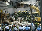 Firefighters removing rubble from the building.