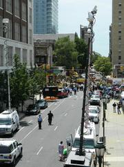 News trucks lined the streets after a building collapse in Center City.