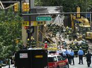 Police and firefighters responding to a building collapse in Philadelphia.