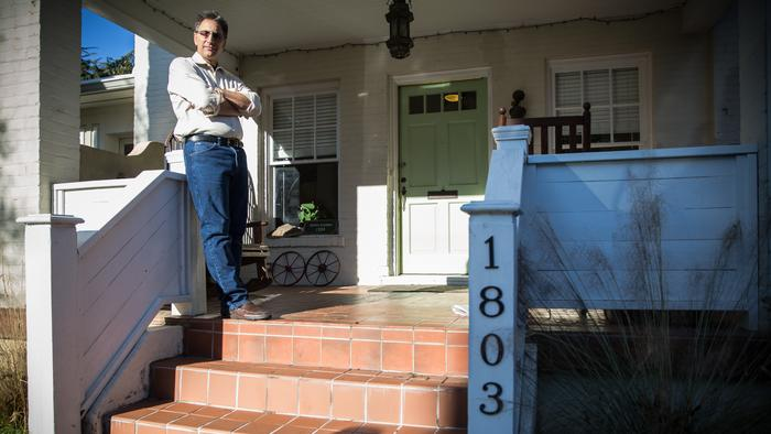 Gregg Stebben poses with his Airbnb rental.