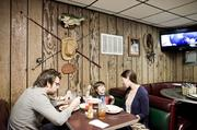 The Dobbs family — Franklin native Lizanna, Ben and their son Nolan — enjoy a meal at Dotson's on 99 E. Main St. in downtown Franklin.