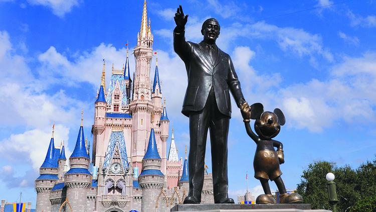 """The iconic """"Partners"""" statue of Walt and Mickey in front of Cinderella Castle. The Magic Kingdom is one of Central Florida's most-visited theme parks."""