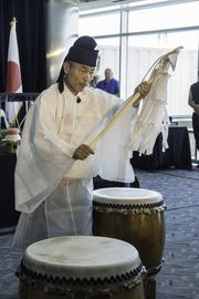 A Shinto priest offers a blessing. United Airlines and Colorado officials mark the debut of United's Denver-to-Tokyo nonstop service at a pre-flight ceremony at Denver International Airport on June 10, 2013.