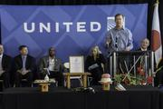 United Airlines and Colorado officials mark the debut of United's Denver-to-Tokyo nonstop service at a pre-flight ceremony at Denver International Airport on June 10, 2013.