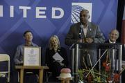 United Airlines and Colorado officials mark the debut of United's Denver-to-Tokyo nonstop service at a pre-flight ceremony at Denver International Airport on June 10, 2013. Speaking: Denver Mayor Michael Hancock.