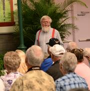 Roger Swain, host of The Victory Garden, talks gardening at the Greenhouse Stage in The Festival Center.