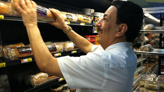 A Deli Associate Stocking Sandwiches At The Neighborhood Walmart On Old St Augustine Road