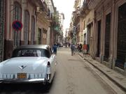 Contrast of an old car and the historic streets of Old Havana.