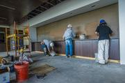 Workers put finishing touches on the boardroom at the new Freightquote headquarters, 901 Carondelet Drive, just days before the firm's 1,100 area employees began moving in.