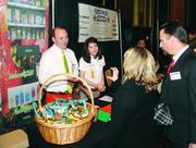 Health 2 Go, LLC's Bob Guckert and Amanda Dukovich chat with booth visitors.