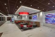 At BofA's new branch, teller stations have been moved to the back and a lounge area welcomes customers entering the building.