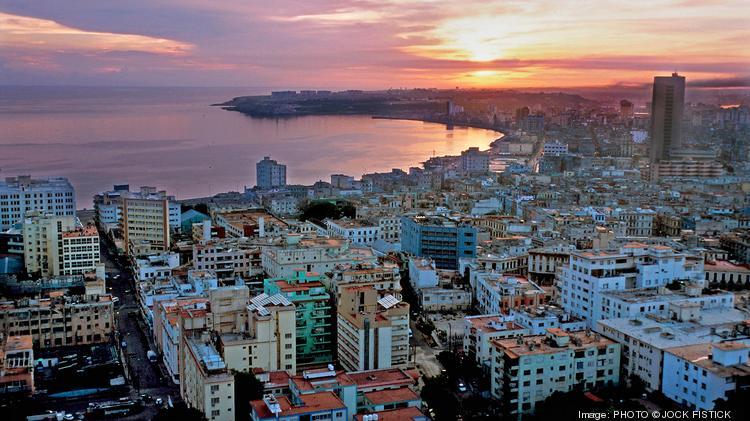The sun rises over the famous Malecon in Havana, Cuba.