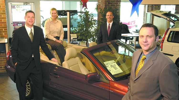 From Left: Craig, Jennifer, Tom And Chris Of The Suntrup Automotive Group.