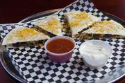 Jefferson Social's cheese quesadillas are served with salsa and sour cream.