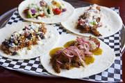 Jefferson Social's taco options are plentiful. Clockwise from bottom right are carnitas, chicken, roasted vegetable and barbacoa.