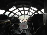 The cockpit, which held the pilot/aircraft commander, copilot, flight engineer (to the right, behind the copilot). The bombardier rode in front of the nearly all-glass nose of the airplane. The navigator's station is off to the left.