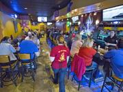 A packed house at a Winston-Salem-based East Coast Wings. The chain's first Memphis location is set to open in mid-April.