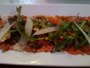 Beef carpaccio with arugula, parmesan and pistachios