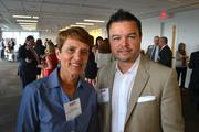 Mary Agee, left, of Northern Virginia Family Service and Hector Velez of HireStrategy.