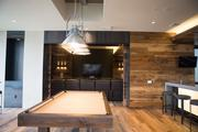 Union Wharf includes a lounge with a pool table, as well as a theater room.