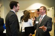 Brent Coughenour of Mass Mutual Pittsburgh, right, chats with Justin Kobic of Bowles Rice.