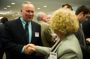 James Droney of Mt. Lebanon Office Furnishings & Interiors shakes hands with Rose Bauman of Continentaloffice.com.