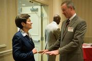 Mary Stollar of the Washington County Chamber of Commerce talks with Patrick O'Brien of First Federal.